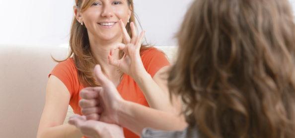 deaf woman using sign language