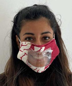 A woman wearing a lip-reading facemask